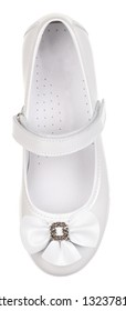 Upper view of white leather girl low shoe with bow-knot, perforated insole and velcro, isolated on white (FOCUS ON INSOLE)
