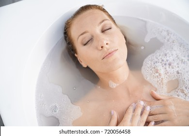 upper view of woman relaxing in bath