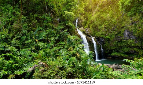 Upper Waikani Falls also known as Three Bears, a trio of large waterfalls amid rocks & lush vegetation with a popular swimming hole, off the Road to Hana Highway, Maui, Hawaii, USA