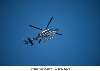 Uppsala, Uppsala län/Sweden - 03/18/2018. The searcher in the air by a Swedish Police helicopter, a Bell 429.
