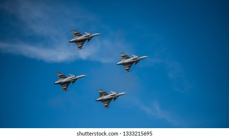 Uppsala, Uppsala län/Sweden - 08/25/2018: Four Swedish JAS 39 Gripen from Saab AB in action at the Swedish Airforces showday at Uppsala Garnison 08/25/2018