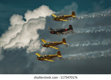 UPPSALA, SWEDEN, 25 AUG, 2018: Team 50 display team with four SAAB Safir and smoke. Cloudy backdrop