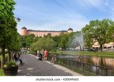Uppsala, Sweden - Jun 1, 2016 : Swan pond against the Uppsala Castle. This pond was built in 1500s and one of the most popular promenades in the center of Uppsala City.
