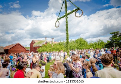 UPPSALA, SWEDEN / JUNE 23 2017: People gathered around Maypole during Swedish Midsommar festival