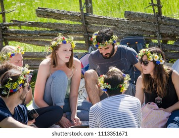UPPSALA, SWEDEN / JUNE 23 2017: Group of young people with flower wreaths at Swedish Midsommar celebration