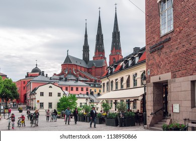 Uppsala, Sweden, June 6, 2018: Cathedral of Uppsala, (70 km from Stockholm) - Gothic-style place of Lutheran worship, consecrated in 1435, with royal tombs. Gamla torget (Old Square) on the foreground
