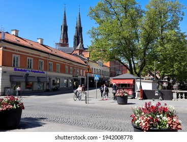 Uppsala Sweden May 17 2019. Spring day in Uppsala city. Famous cathedral in the background. Beautiful flowers on a square in Swedish town north of Sweden.