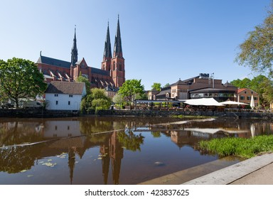 Uppsala, Sweden - May 20, 2016 : Uppsala Church with its reflection on the river.