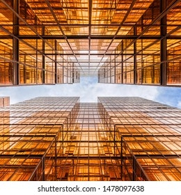 Uprisen angle of Hong Kong skyscraper with reflection of clouds among high building, Building glasses, business and financial, Architecture and industrial concept