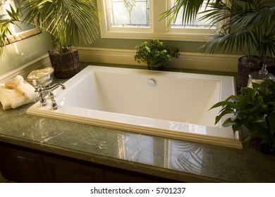 Upscale bathroom with a modern tub and tile floor