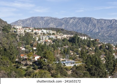 Upscale Los Angeles County hillside homes with San Gabriel mountains backdrop.