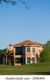 Upscale luxury house in tropical environment near the golf playground
