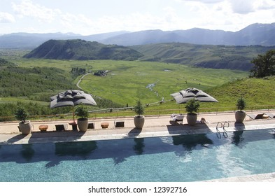 Upscale resort and spa has a pool terrace overlooking the valley and mountains in Wyoming