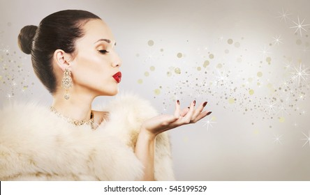 Upscale woman wearing gold jewellery and red lipstick on light background