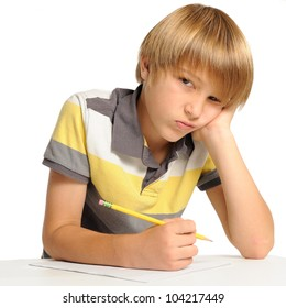 Upset about Homework. Elementary school student frustrated about doing homework. Looking at viewer. Isolated on white.