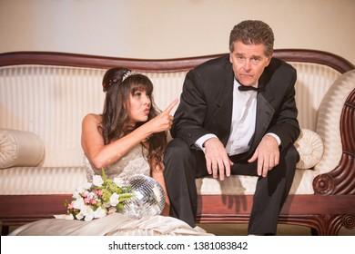 Upset bride pointing at new husband