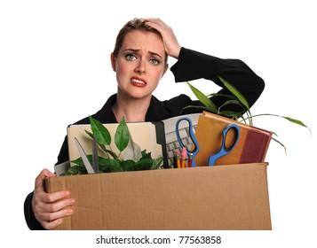 Upset businesswoman carrying office belongings after loosing job
