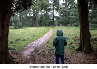 Upset child suffering from anxiety and depression seeks comfort and peace in nature
