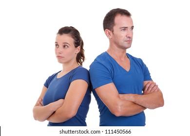 upset couple, back to back , isolated on white, studio shot