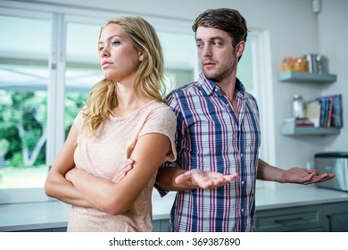 Upset couple having an argument in the kitchen