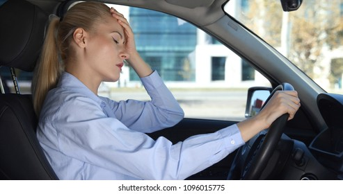 Upset Driver Business Woman Have Nervous Reaction Inside Vehicle Stuck in Traffic, Sad or Sick Female in Head Pain Sitting in Driver Place of her Private Car