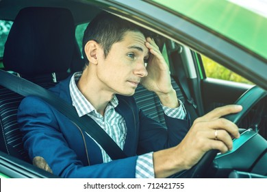 The upset driver man in the car. Quarrels and discontent in the road