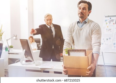 Upset fired employee being asked to leave the building