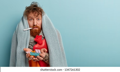 Upset foxy man feels badly, calls doctor, has symptoms of cold, suffers from fever, wrapped in warm coverlet, measures temperature, warms himself with hot water bottle, holds pills, Sickness