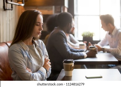 Upset girl ghosted by boyfriend, waiting for him alone in coffeeshop, frustrated female rejected by admirer or lover, wasting time for cancelled date, sad outcast jealous of happy friends in cafe,