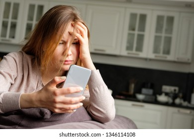 Upset girl with a phone