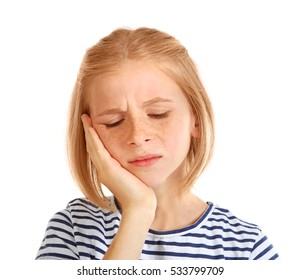Upset girl with toothache isolated on white
