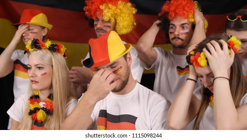 Upset Group of Fans People or German Supporters Looking Sad after Football Team Failure in International Sport Event