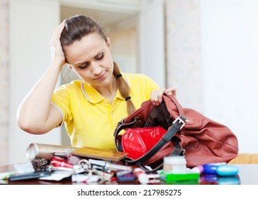Upset inconsiderate woman lost something  in her purse