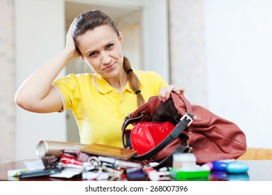 Upset inconsiderate woman lost something
