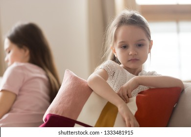 Upset kid daughter sad after family conflict fight with mother feeling lack of love and attention, offended little child girl pouting ignoring mom depressed by punishment in unhappy childhood concept