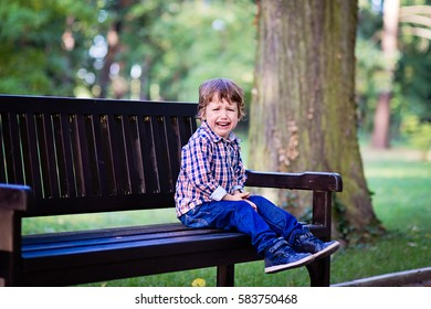 Upset little baby boy crying outdoors. Toddler having tantrum in the park