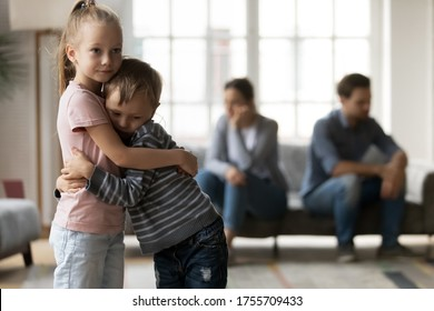 Upset little girl and boy, sister and brother hugging, suffering from parents quarrel close up, family conflict, offended mother and father ignoring each other after argument, children and divorce - Shutterstock ID 1755709433