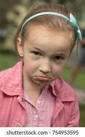 Upset little girl look at camera