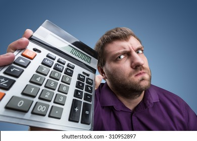 Upset man with calculator
