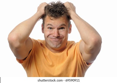 Upset man pulls his hair out