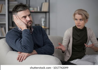 Upset man refusing to listen to his constantly complaining wife