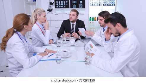 Upset Manager Man Talking to Sad Medical Team Doctors About Pie Chart Data Negative News about Hospital Yearly Results, Clinical Audit in Healthcare Center