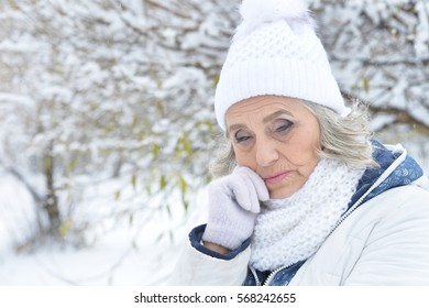 upset mature woman portrait outdoors