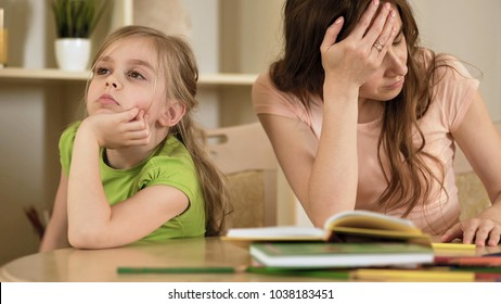 Upset mother is angry to little bored daughter, homeschooling, misunderstanding