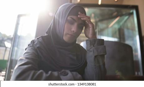 Upset Muslim lady suffering loneliness, thinking problem,