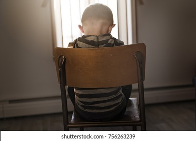 A Upset problem child sit on chair concept for bullying, depression stress