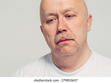 Upset senior man portrait depression on white background