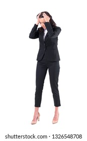 Upset stressed business woman with head in hands looking down in despair. Full body isolated on white background.