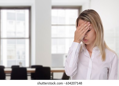 Upset, stressed and worried businesswoman in an office