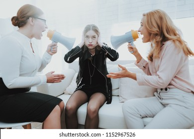 Upset Teenage Daughter in Jacket in Psychologist Office with Mother. Punk in Lather Jacket. Communication Concept. Psychotherapy Concept. Puberty Problems. Conflict in Family. Family Doctor.